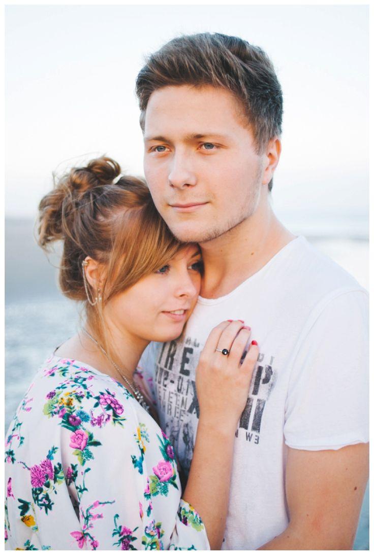 Romantic portrait of a young engaged couple on the beach www.ellen-richardson-weddings.com/blog