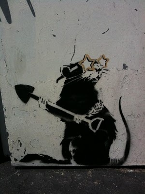 street art by banksy.  000 rat