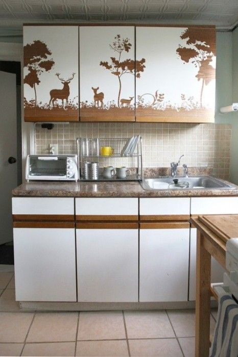 Check out these cabinets covered in contact paper with an intricate outdoor design.