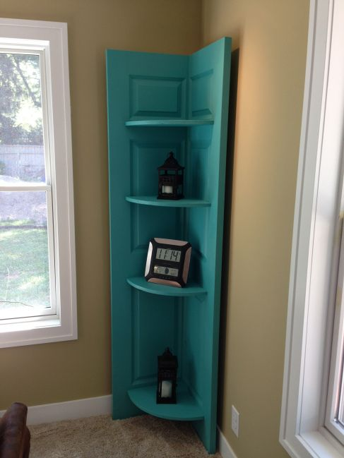 DIY shelf made from an old door. It is so easy and unique. I love this project.