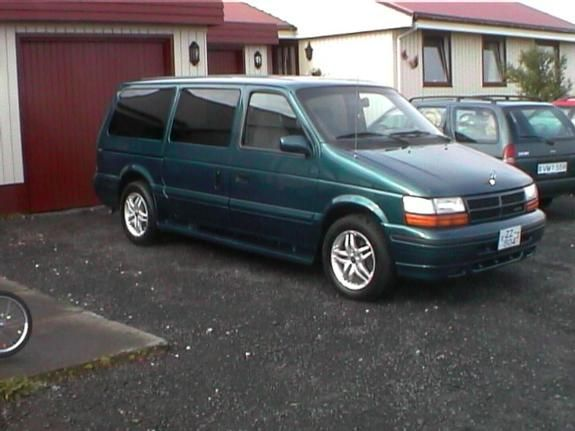 Dodge Caravan. My first van and 4th car.  It was maroon, saw lots of miles to and from nursing school and dog shows.  It was this length with the dark windows.