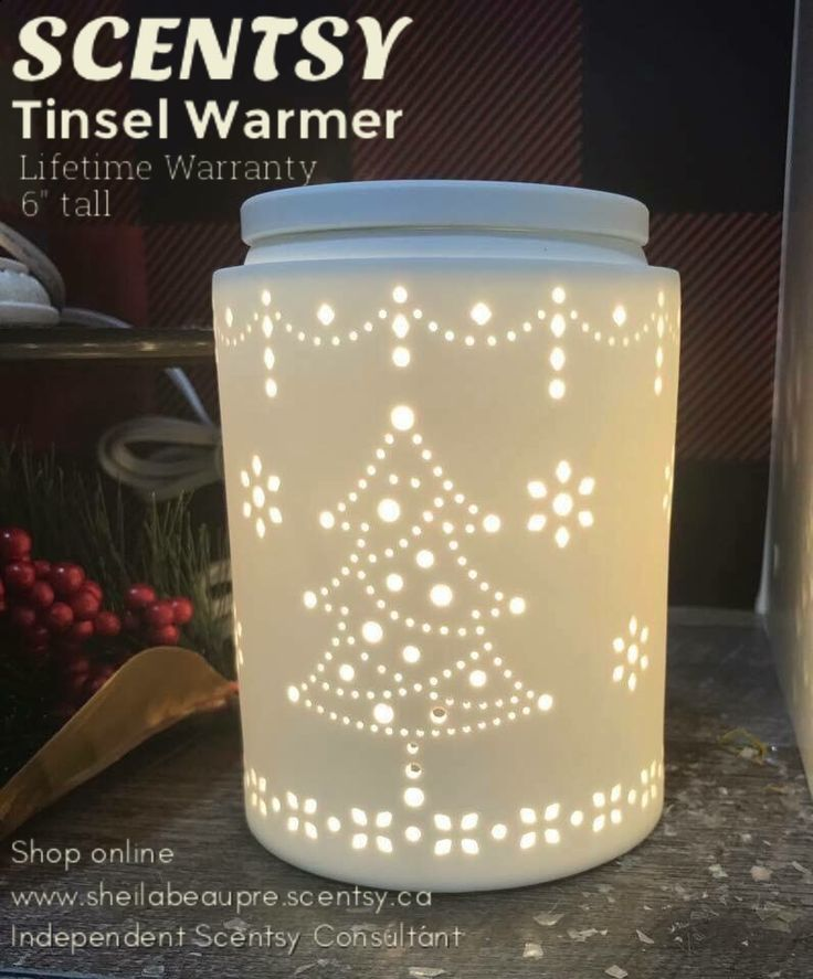 SCENTSY WARMER  LIFETIME WARRANTY  TINSEL Warmer  You know that holiday sweater you'll love forever? Tinsel captures its charm in spades with stitch-like detail and a warm, cozy vibe.