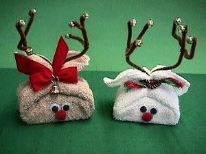 Photo: ~~***Stocking Stuffer Idea - Cute Washcloth & Soap Reindeers***~~  Materials needed: Two standard-sized washcloths, tan and white 2 bars of bath-size soap 4 wiggle eyes 2 red pompoms 4 brown pipe cleaners 2 rubberbands 12 tiny jingle bells Decorative cord or ribbon Velvet ribbon for bow Small bell for Rudy Tacky glue Blush make-up for cheeks  Directions: 1. Open washcloth and place it on the table with one corner facing you. This makes the washcloth a diamond shape.  2. Place the soap…