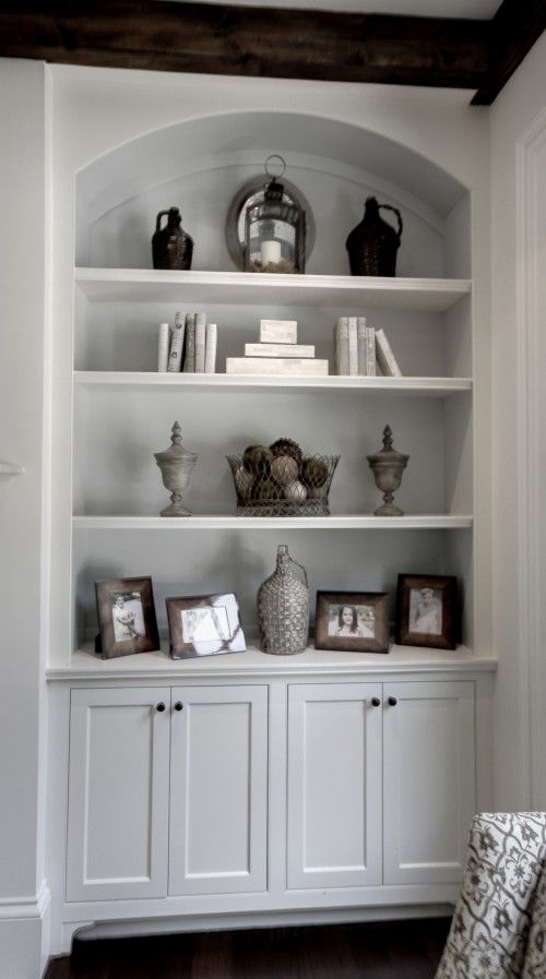 Built in bookshelves. Like the way they styled the accessories. See Spacecreators in Grand Junction, Colorado for custom storage solutions!