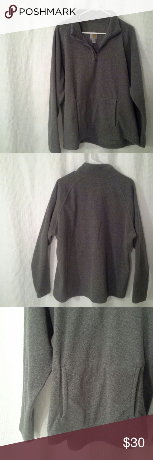 Super Warm Carhartt Pullover Beautiful gray sweatshirt with front pouch pocket. Nice and cozy.  I have worn this both by itself or over another shirt/turtleneck and I have never overheated in it.  In great shape.  Just doesn't fit me anymore.  100% Polyester. Carhartt Tops Sweatshirts & Hoodies
