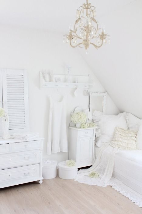 very cute, very white room. nice use of flowers x