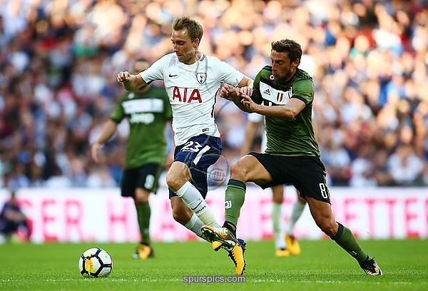 LONDON, ENGLAND - AUGUST 05: Christian Eriksen of Tottenham Hotspur tackles with Claudio Marchisio of Jeventus during the Pre-Season Friendly match beween Tottenham Hotspur and Juventus at Wembley Stadium on August 5, 2017 in London, England
