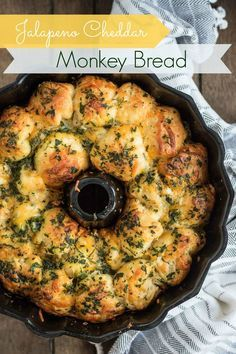 Jalapeño Cheddar Cream Cheese Stuffed Monkey Bread - This savory pull apart monkey bread is stuffed with cream cheese dip and loaded with jalapenos and cheddar.