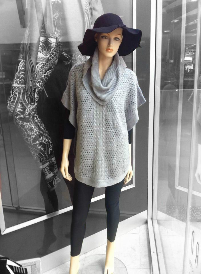 High turtle neck knit, great paired with black 3/4 sleeve top, black tights and boots. Add a floppy hat to complete the look.