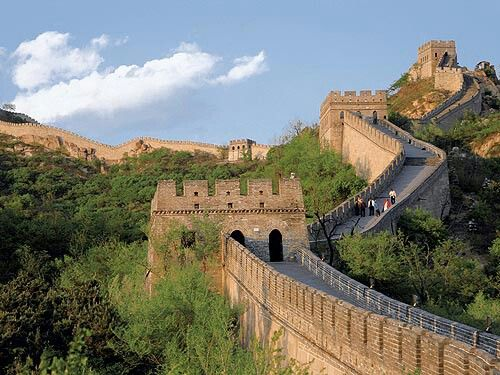 Great Wall in China. The Wall can be seen from space, spans thousands of kilometres and passes through deserts, mountains, and grasslands. The UNESCO heritage site is actually comprised of four different walls built by various emperors between 214 BC to 1569 CE.