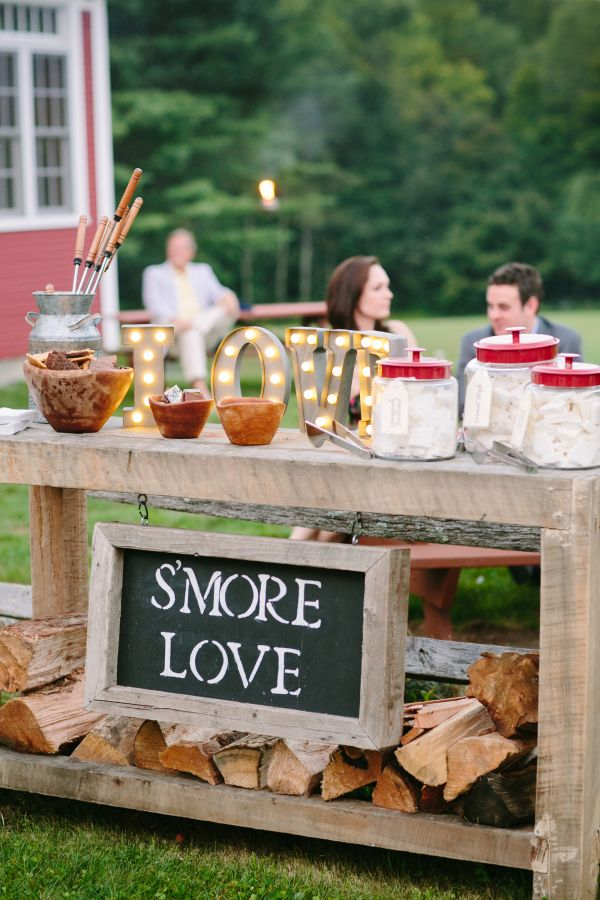 Give your guests a sweet treat with this DIY smore creation station. Fun for all ages this creative food station will be enjoyed by all attendees. Find more wedding ideas here: http://www.diys.com/rustic-wedding-ideas/