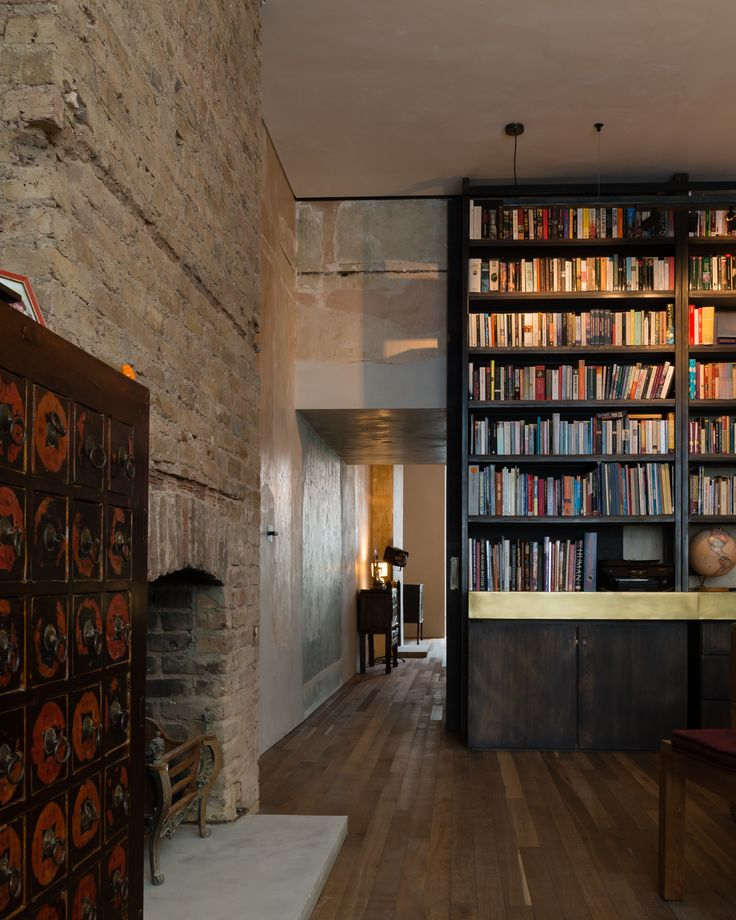 Refurbishment of terraced home in Belsize Park, London.    Living Space. Bookshelf. Materials.  Detail.  Interior Design.    Solid Timber Floor by Ted Todd. Polished Plaster by Calfe Crimmings. Joinery by Goldcrest of London. Photographer - Jim Stephenson. Contractor - Mallett Construction.