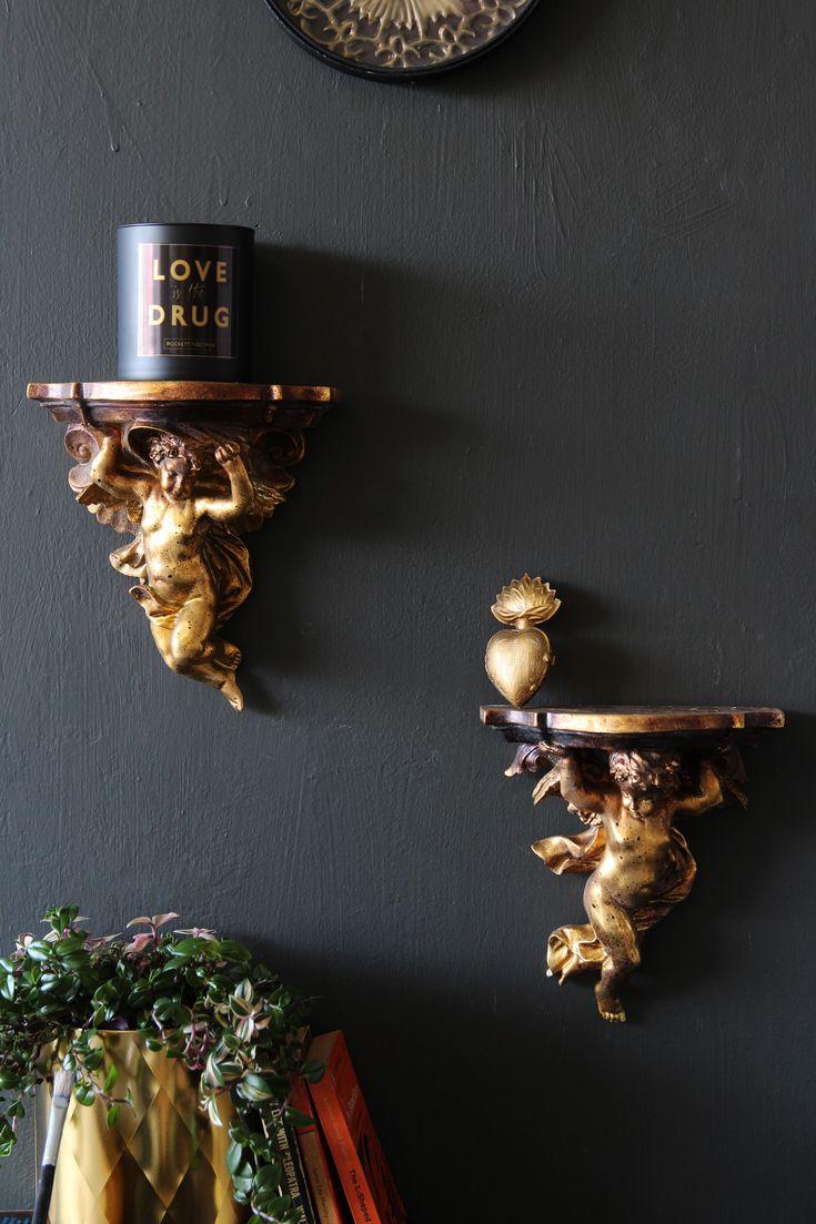 pair of cherub shelves shelves pair love candle gold wall