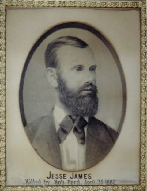 JESSE JAMES Killed by Bob Ford, April 3rd 1882. Photo of this original picture hanging in Jesse's St. Joe Home was taken in the early 1980's.