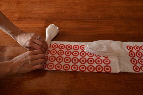 reusing a wipes container for plastic shopping bags - plus a wonderful demonstration for folding those bags to pop out of the container one by one...