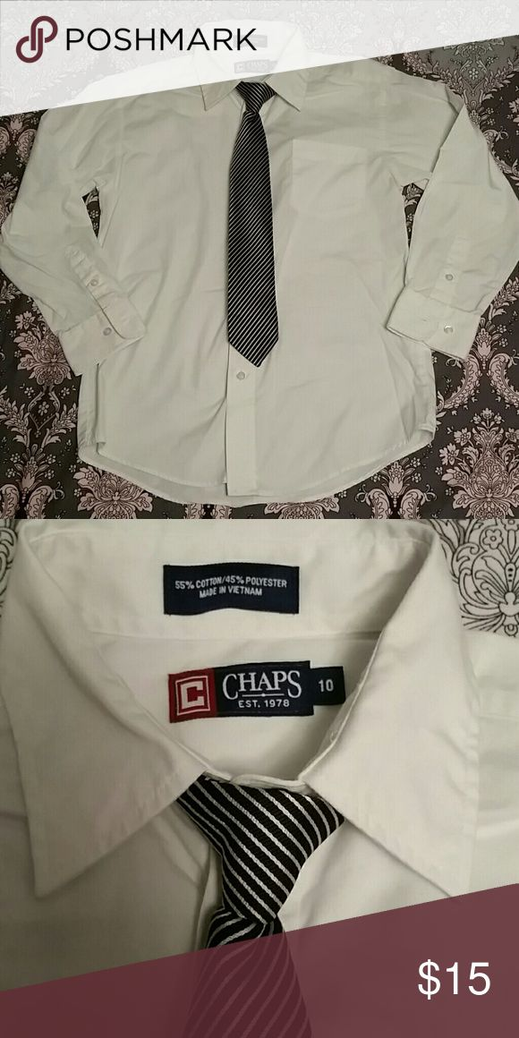 Chaps Ralph Lauren White Button down & Tie Chaps Ralph Lauren White Button down & Tie set. All white button down shirt with a striped clip on tie. Handsome little set. Worn Twice for school events. EUC Chaps Shirts & Tops Button Down Shirts