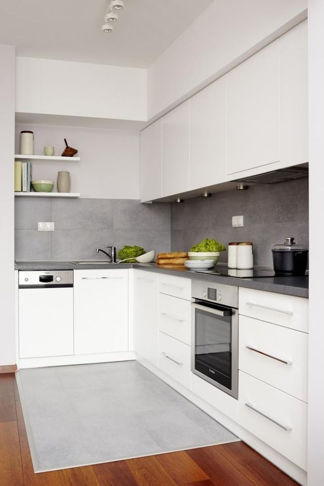 Neat white and grey kitchen missing white backsplash magnet strip