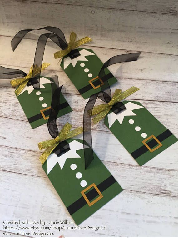 ♥︎♥︎♥︎ADD A LITTLE EXTRA PIZZAZZ TO YOUR GIFTS AT A VERY AFFORDABLE PRICE♥︎♥︎♥︎ This listing is for one set of six (6) Christmas gift tags. Each tag, measuring approximately 3 x 2, consists of a green base layer topped with white buttons and a collar. The elfs black belt is