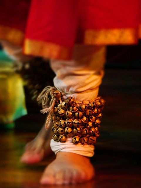 Indian classical kathak exponent.  A musical anklet tied to the feet of classical Indian dancers. The sounds produced by Ghungroos vary greatly in pitch depending on their metallic composition and size. Ghungroos serve to accentuate the rhythmic aspects of the dance and allow complex footwork to be heard by the audience.