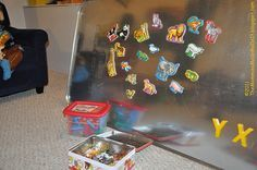 Oil drip pan magnet board! Genius! perfect for the play room wall