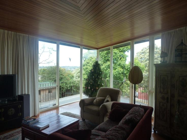 Existing Conditions - Living room looking towards the arrowhead verandah and view.  Secret Design Studio, Melbourne. www.secretdesignstudio.com