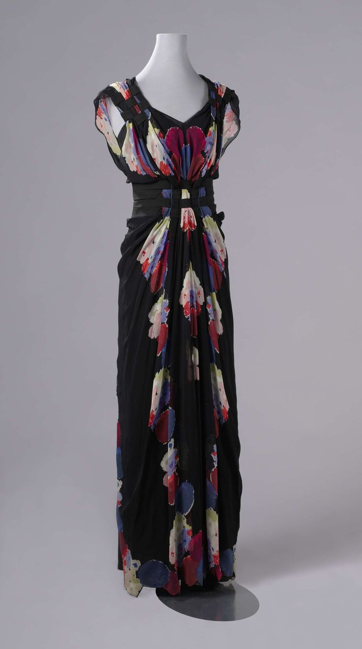Evening gown of black crepe georgette, printed with colorful flowers, comprising a body (a) and a skirt (b), with corresponding slip (c), Nina Ricci, 1938