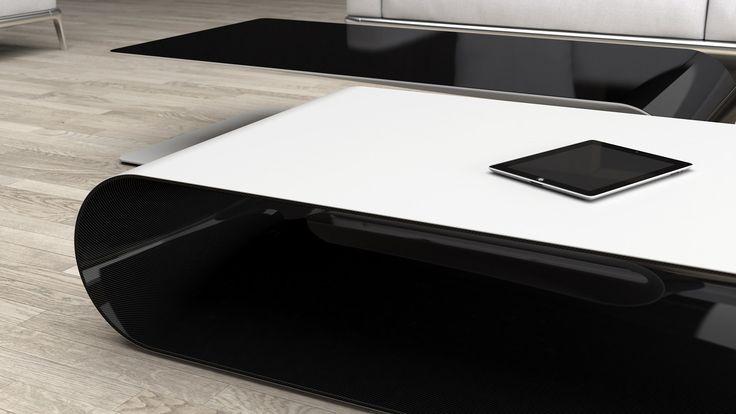 BOOMERANG/carbon. low table made of carbon fiber. matte white top, transparent laquered carbon fiber inner part.