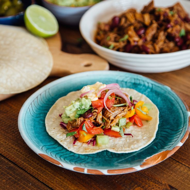 Delicious easy tacos that are great for entertaining - easily made in advance and lots of fun to eat! Slow-cooked pulled pork with lots of tasty sides!