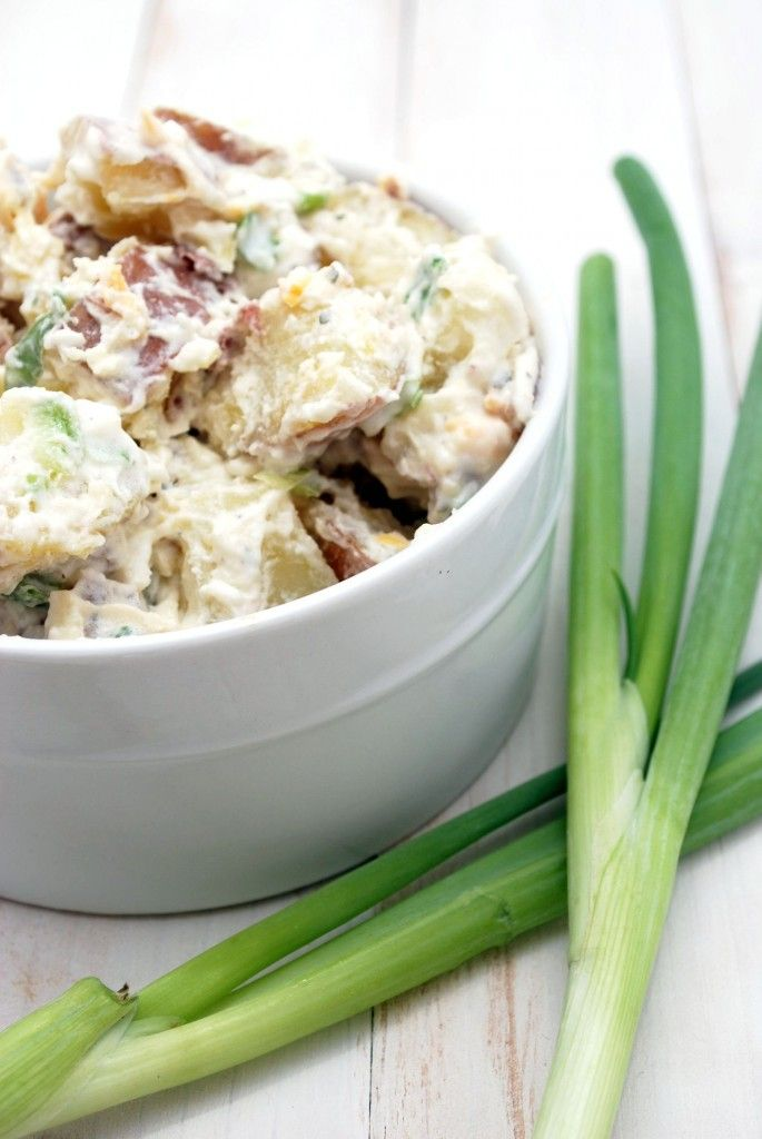 Texas Ranch Potato Salad  Ingredients:    5 lbs red potatoes, unpeeled and cut in half  1 cup mayonnaise  1 cup sour cream  1 1-oz package of dry ranch mix  6 green onions, sliced thin  1/2 cup shredded cheddar cheese  8 slices of bacon, cooked until very crisp and crumbled (prepare right before serving)