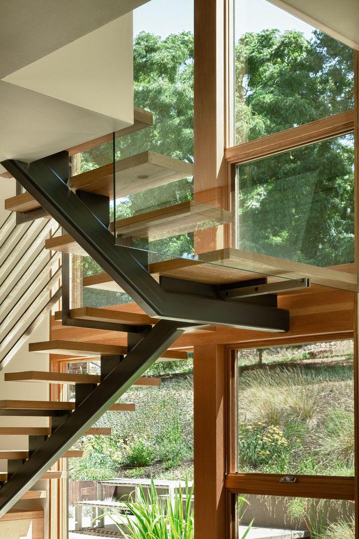 modern architecture - open riser stair detail, glass rail, single stringer
