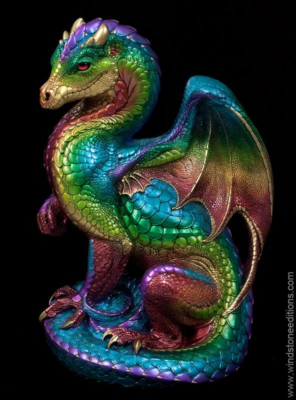 Secret Keeper - Rainbow - She matches the rest of the gaudy Rainbow dragon family with the exception of her soft red eyes (other rainbows have deep blue eyes). She has a light topaz colored jewel. I think she wears this color well. She is an unsigned, limited production! #dragon #statue #fantasyart $1,200