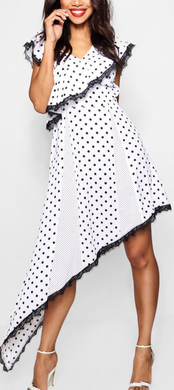 Boohoo Polka Dot Black and White Dress with Frills trim shoulders, and playful hi-lo asymetric hem. Fun for spring summer wedding outfit ideas. Racing fashion, day at the races Grand National, Royal Ascot, Epsom Races. #racingfashion #polkadots #blackwhitedress #mididress #summerfashion #fashion #fashionista #affiliatelink #monochromedress #ascotoutfits #weddings #royalascot #bossbabe #ascot