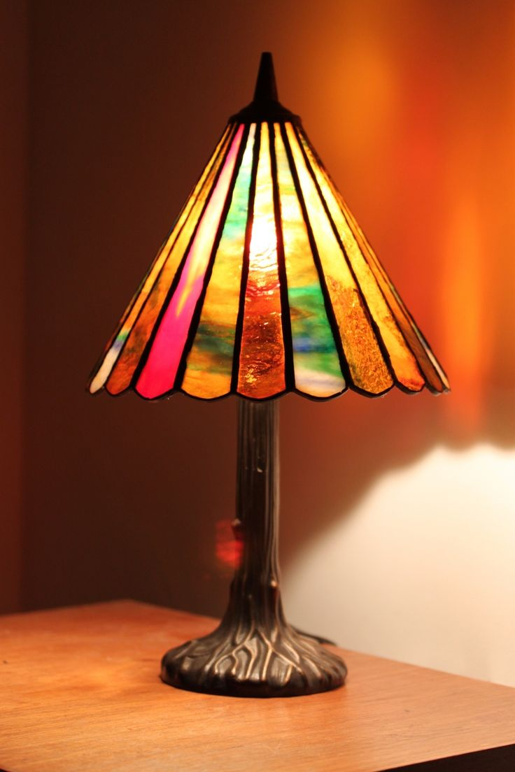 Orange and turquoise lamp shade - Stained Glass Lamp With Cuted Glass Shaped Slices In Shades Of Red To Turquoise Seated In An Elegant Base Of Hand Finished Mahogany Bronze