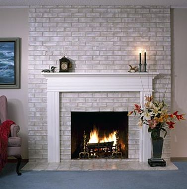An easy update to the 80's full brick wall fireplaces. You can even go one step further and paint the brick in the inside of the mantle another color, leave it natural or even do a mortar treatment over it.