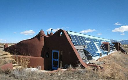 """Called """"Sol Ship,"""" this one-bed, one-bath earthship is designed for off-the-grid living and uses passive solar thermomass construction that heats and cools the interior. But don't worry — you can tap into traditional systems if you have a craving for microwave popcorn.  Two underground, 3,000-gallon cisterns hold water. Own this home and no one will insult you about your carbon footprint, because it doesn't exist."""