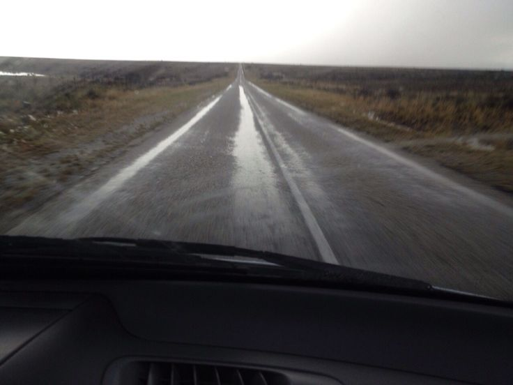 Wet roads disappearing into the clouds after an afternoon storm in the Karoo