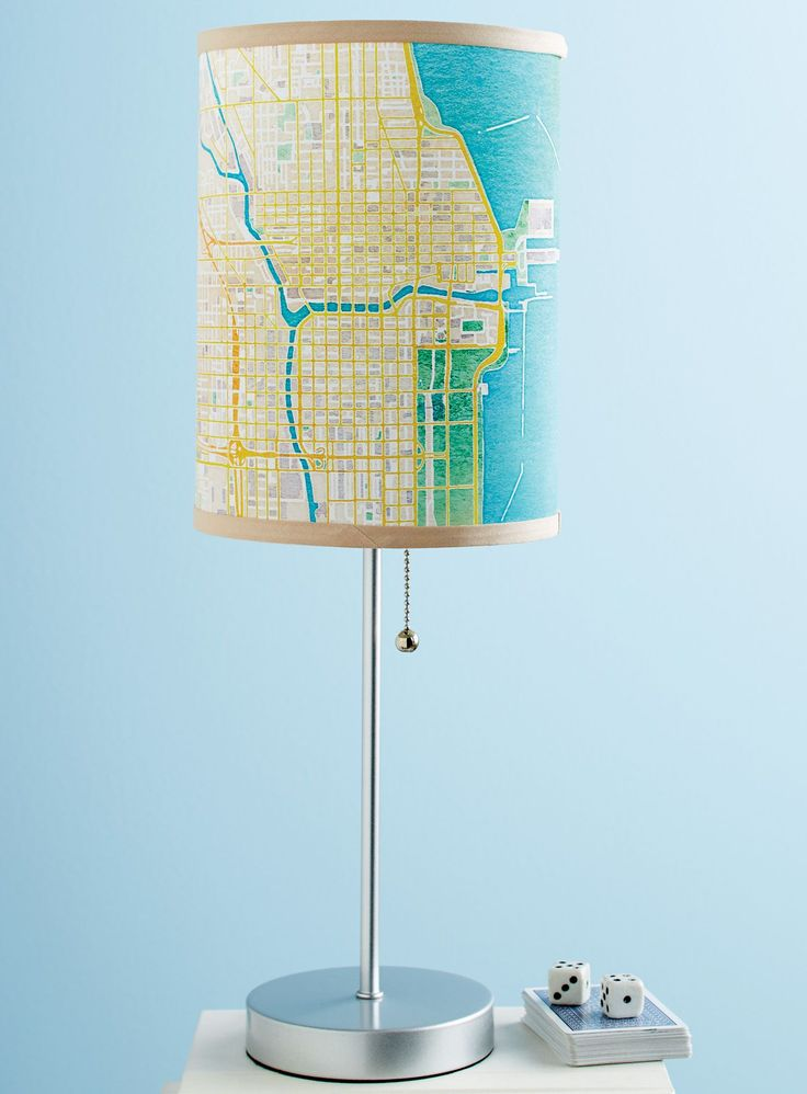Personalized Watercolor Abstract Map Lamp - The places we love cast a glow across our lives—and our unique lamp brings that idea to life. Provide any address in the world, and designers in Rhode Island will create a lampshade featuring an abstract map of the area. We've gotten the best results with addresses that have some water and open spaces nearby for a variety of colors. Lampshade is made from ribbon-edged Poly Duratrans film; the base is white aluminum.