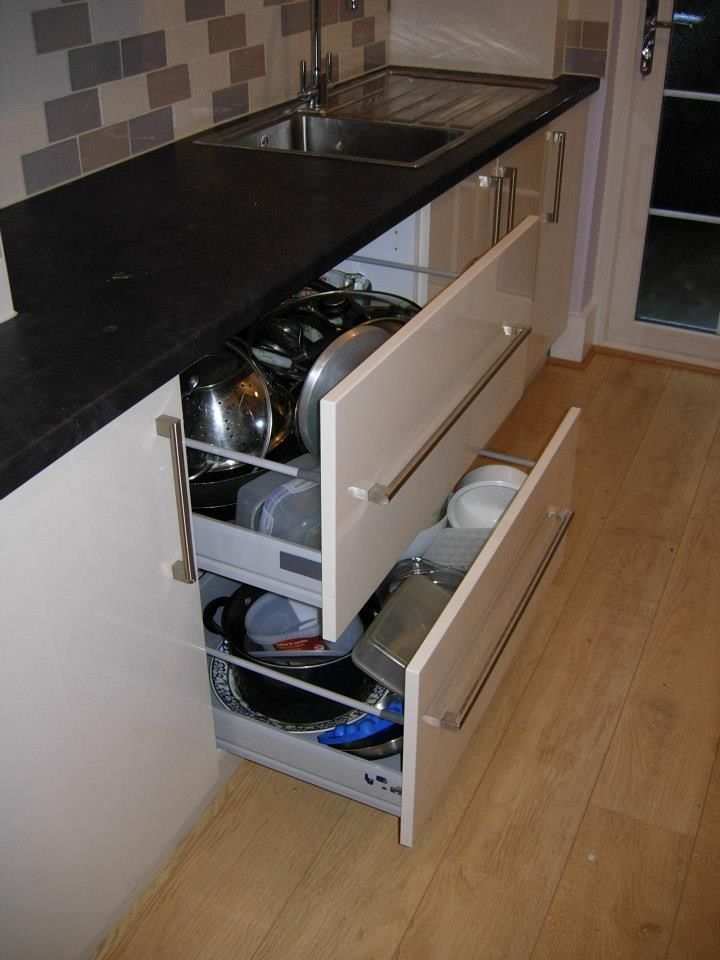 This shows pull out pan drawers which are a good way to store pots and pans while making them accessible.  http://www.ppmsltd.co.uk