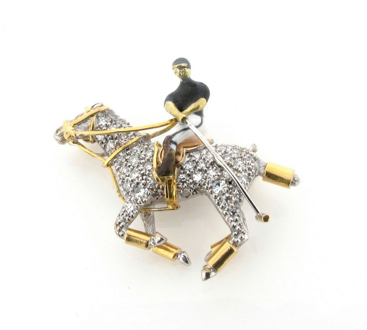 A diamond set gold polo player and pony brooch, highlighted with black and white enamel and set in yellow and white 18ct gold.