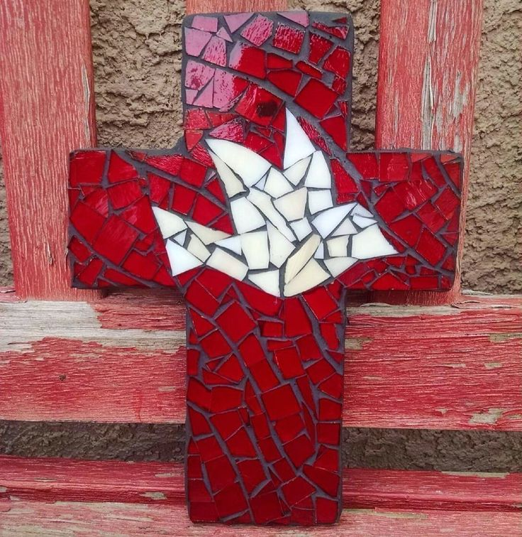 9 inch X 6 inch Handcrafted Mosaic Dove Wall Cross, Ivory and Red stained glass with charcoal colored grout. 9 inch X 6 inch Handcrafted Mosaic Wall Cross. Made with hand cut stained glass.Grouted with Charcoal colored unsanded grout. These are handcrafted, each one is unique and could have a slight variance in the glass size and color. No two are exactly the same.