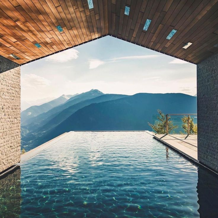 Miramonti Boutique Hotel, Hafling-Merano, Italy.  The Miramonti Boutique Hotel features a private spa 1.230 metres above sea level. The infinity pool is like a warm cave leading to the stunning mountain scenery in all four seasons, caressed by 32°C warming, healing salt water and floating high above the Merano basin below  @miramontiboutiquehotel