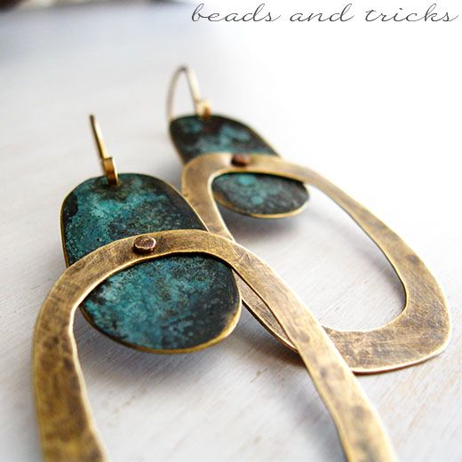"Earrings in brass ormolu and blue patina  // not sure what ""ormulu"" (translated from Italian) is these days, though...."