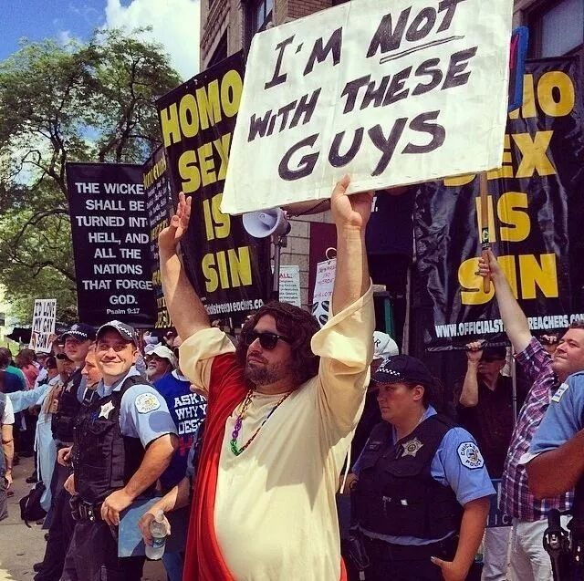 From Sunday's Gay Pride Parade in Chicago. The cop on the right knows whats going down.