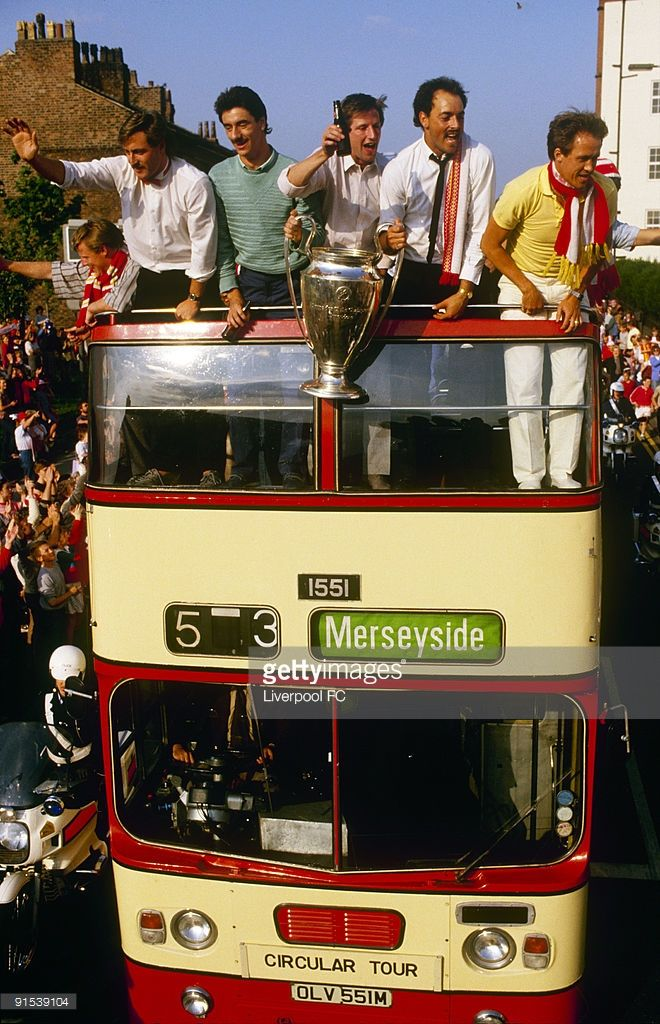 Liverpool players parade the European cup trophy from on top of an open bus for a victory parade through the city (from left to right) David Hodgson, Ian Rush, Ronnie Whelan, Bruce Grobbelaar and Phil Neal on June 1, 1984 in Liverpool, England.
