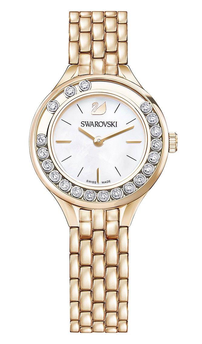 Swarovski Dameshorloge Lovely Crystals Mini 5261496. Elegant en speels vormgegeven horloge met 20 sprankelende Swarovski-kristallen, die speels rondom de kast glijden. De stalen, rosékleurige kast heeft een Parelmoer wijzerplaat met een zilverkleurige index en wijzers. De rosékleurige horlogeband sluit door middel van een vouwsluiting met drukkers. Het horloge is 50 meter waterdicht en voorzien van een Zwitsers uurwerk. Een dameshorloge met een oogverblindend design.  #gold #swissmade #staal…