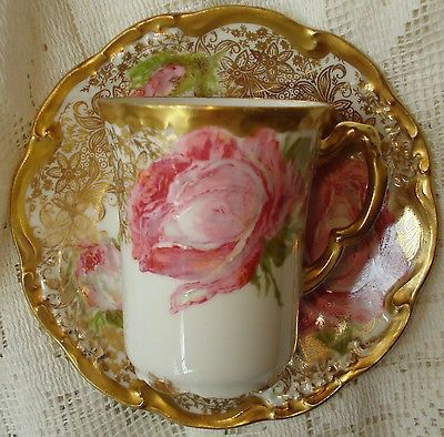NOTE: WE NO LONGER ALLOW PROXY BIDDERS. This is an incredible antique authentic Limoges porcelain chocolate or tea cup and saucer. When have you ever seen antique porcelain like this? The handles and