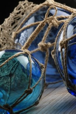 24.99 SALE PRICE! A lovely accent for a beach house or decoration for a seaside wedding, these 3 blue glass nautical floats on a rope lanyard make a colorful...