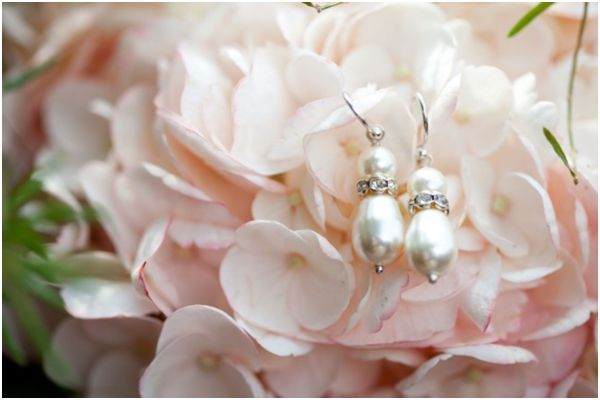light pink hydrangeas, pretty pearl drop and diamond earrings, bridal accessories, pink and white Southern shabby chic wedding