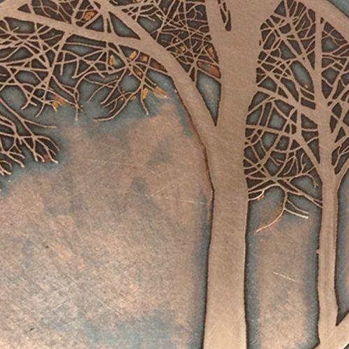 close up of etched copper disc by Caroline McGuigan
