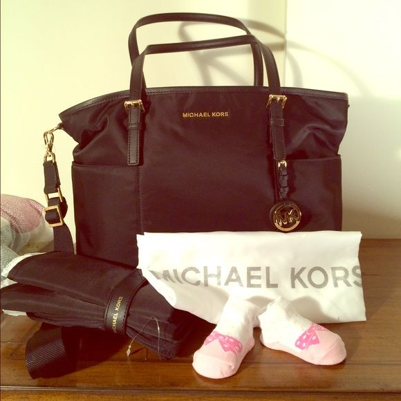 "Diaper Baby Bag Michael Kors Jet Set Black NWT! Gorgeous 100% Authentic diaper bag. Black color combined with golden hardware.  Comes with changing pad. Paper work and tags are attached.  Perfect new condition.  Long strap is adjustable and detachable as well. Baby socks are not included :)  Measurements: L16.5""/ H11.5"" Handles: 10"" Drop Strap: 14""/22""   Retail price: $298 Michael Kors Bags Shoulder Bags"